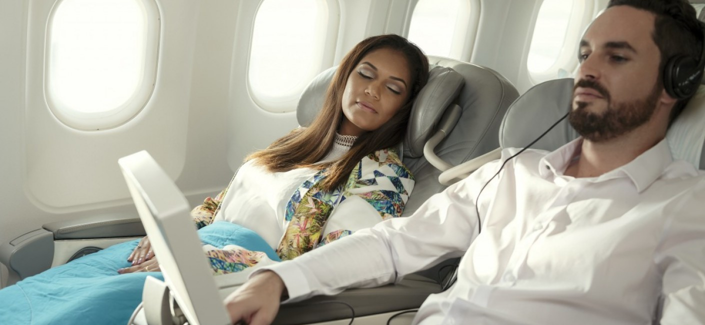 Business Class Reclining Seats With Passengers Sleeping