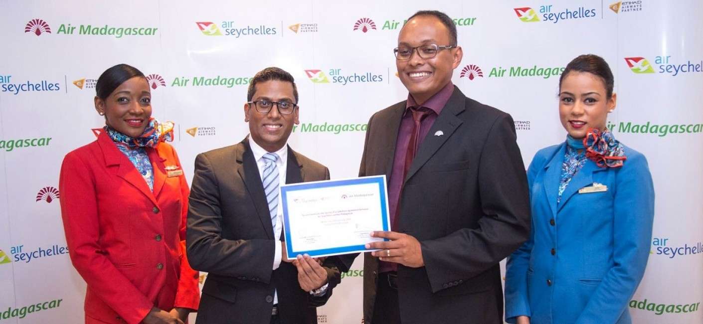 Manoj Papa, Air Seychelles' Chief Executive Officer, and Hery Rambeloson, Air Madagascar's Commercial Passenger Director, celebrate the signing of the new codeshare agreement between the two airlines