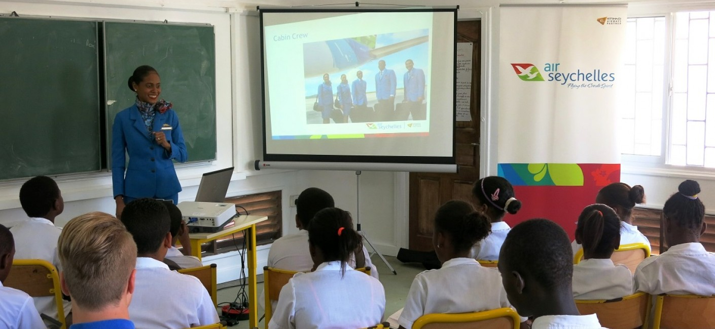 Meryl Jean explains the role of Air Seychelles Cabin Crew to children at L'Ecole Française