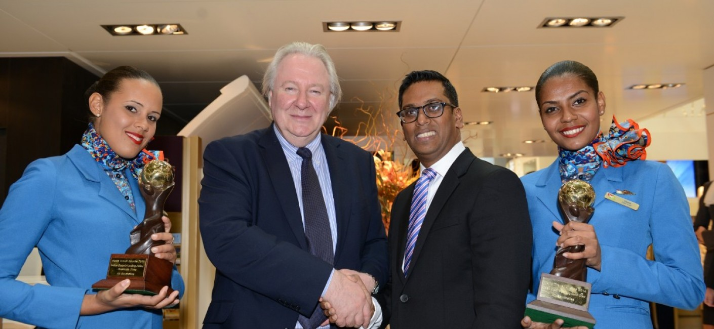 Manoj Papa, Air Seychelles' Chief Executive Officer, is congratulated by Graham Cooke, President and Founder of the World Travel Awards, after being presented with trophies for best 'Business Class' and 'Best Cabin Crew in the Indian Ocean'. On either side are Air Seychelles Cabin Crew, Vania Payet, on the left, and Laureen Loze