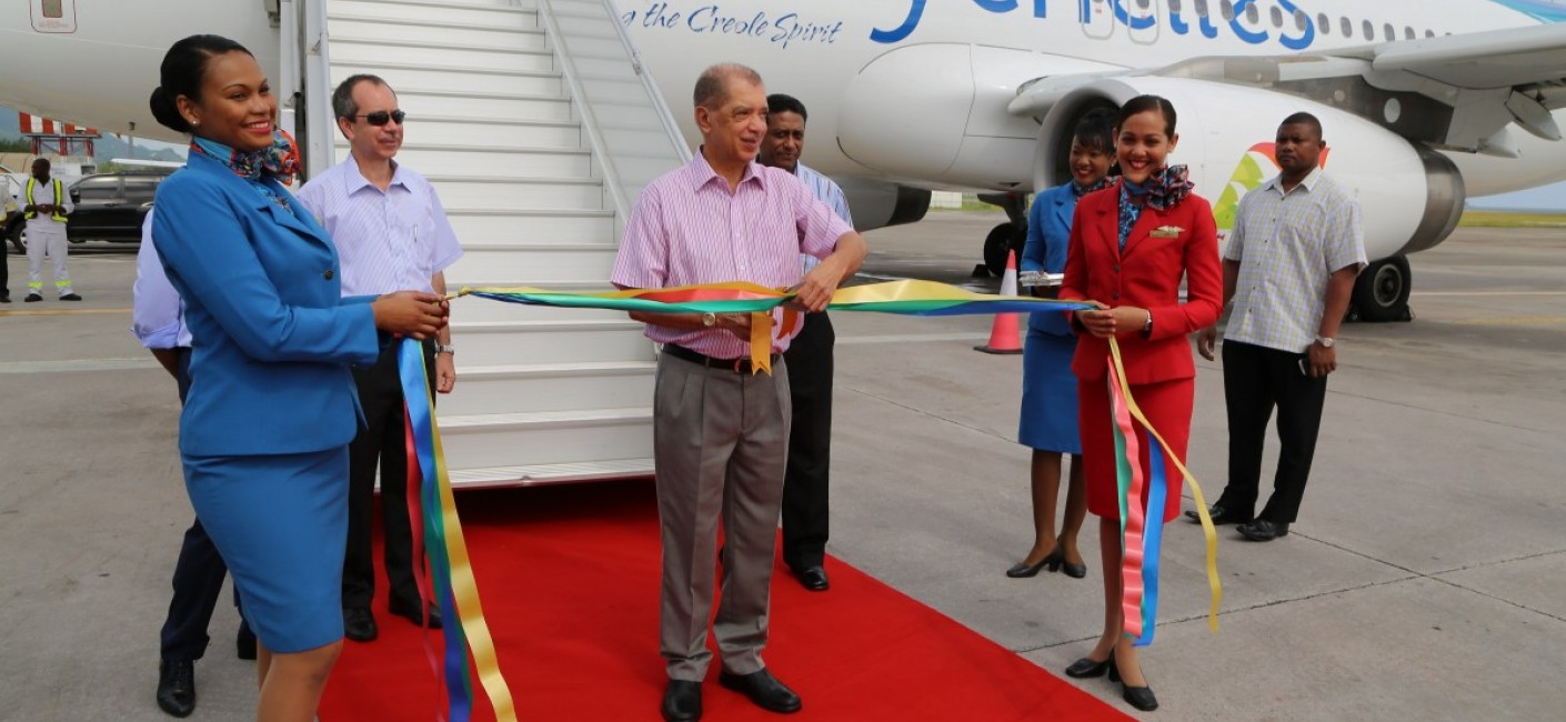 President James Michel cuts a ribbon to welcome the new aircraft to Seychelles