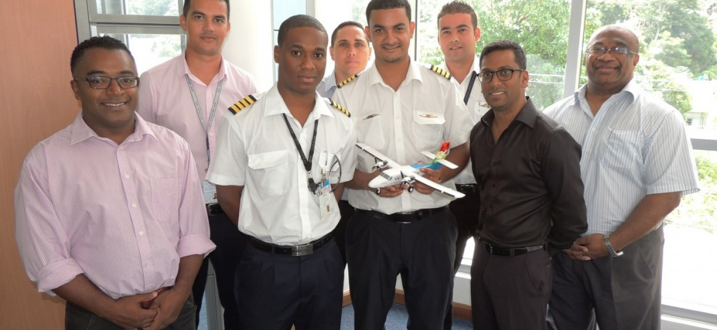 (From left) Alan Renaud, General Manager Corporate Affairs, Allen Dubignon, Chief Pilot Domestic, Captain Russel Morel, Captain Sandy Benoiton, Head of Crew Training, Captain Juan Romain, Captain Bertrand Mein, Manoj Papa, Air Seychelles' Chief Executive Officer, and Captain Granger Narara, Head of Flight Operations, pose for a souvenir photograph
