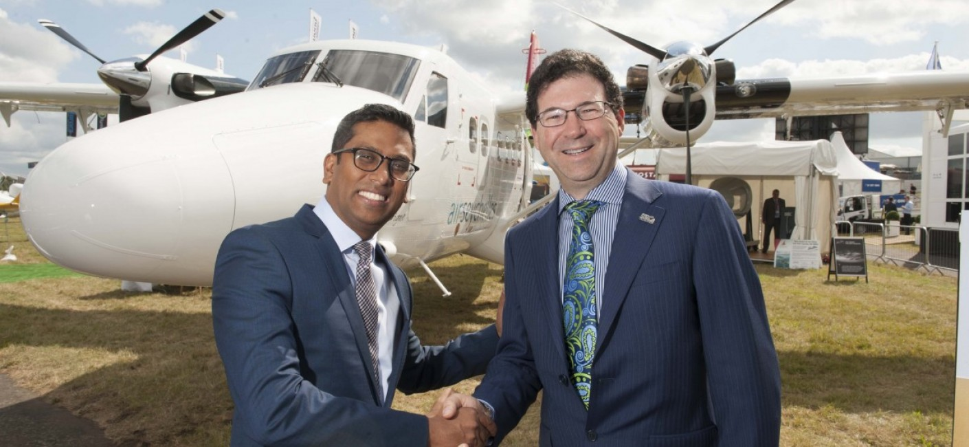At the Farnborough Air Show in England, Air Seychelles Chief Executive Officer, Manoj Papa, and Viking Air President & Chief Executive Officer, David Curtis, celebrate the delivery of Air Seychelles' new Twin Otter 400 Series aircraft