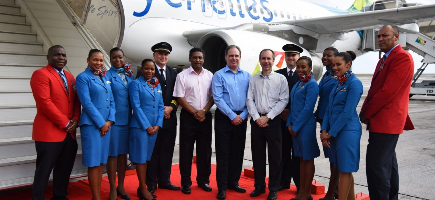 Vice President of Seychelles, Danny Faure, Chief Executive Officer of Air Seychelles, Roy Kinnear and Minister of Foreign Affairs and Transport and Chairman of Air Seychelles, Joël Morgan, stand next to the Seychellois pilots and cabin crew who operated 'Silhouette's' first flight from Abu Dhabi to Seychelles