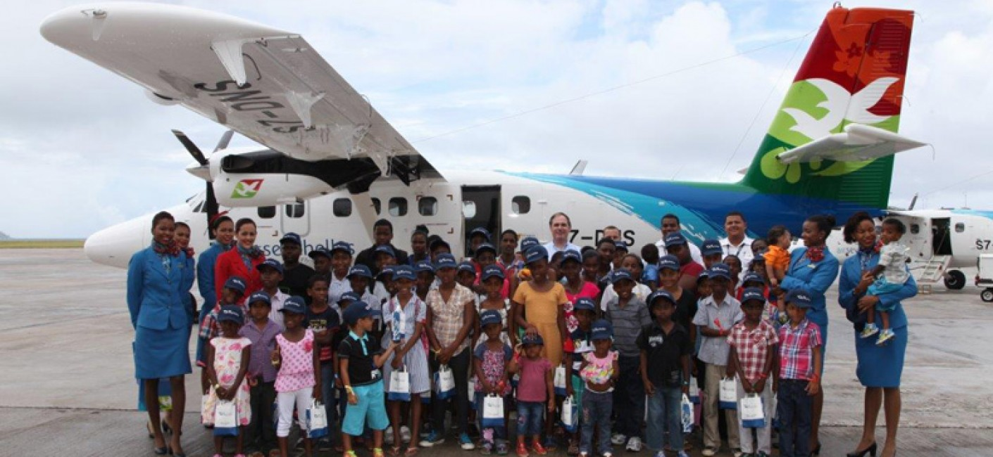 Air Seychelles CEO with children: Air Seychelles CEO Roy Kinnear and children from the President's Village and Anse Boileau school