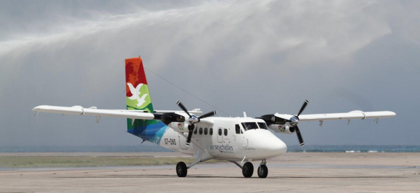 3.	Air Seychelles new twin otter Isle of Denis welcomed by the water cannon salute at Mahe International Airport, Seychelles