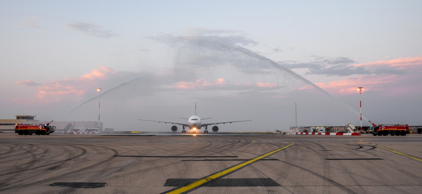 Flight HM16 is welcomed by a traditional water-cannon salute at Charles de Gaulle Airport