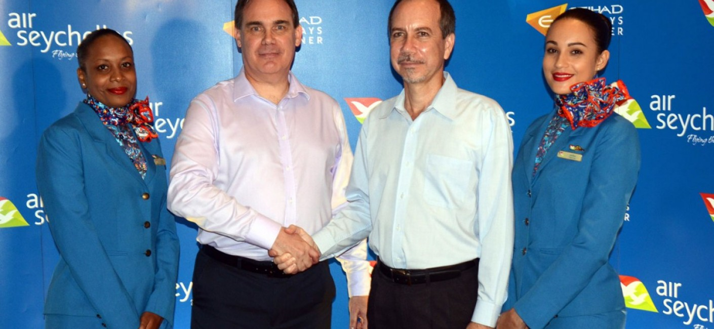 Minister Joël Morgan shakes hands with Roy Kinnear, the incoming Chief Executive Officer of Air Seychelles